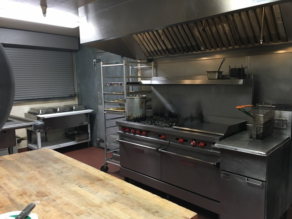 The kitchen as it looks now. Our heroic cooks provide meals for the whole house and commissary for another facility from this overworked space.